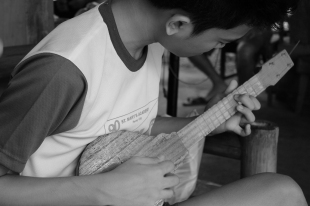 My cousin | It's a common photo, but there's just something about a person playing a guitar in photos.