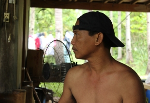 My uncle | I didn't change it to black and white because I didn't want to waste the colours. The electric fan kind of ruins the shot for me, but maybe that's what makes it beautiful.